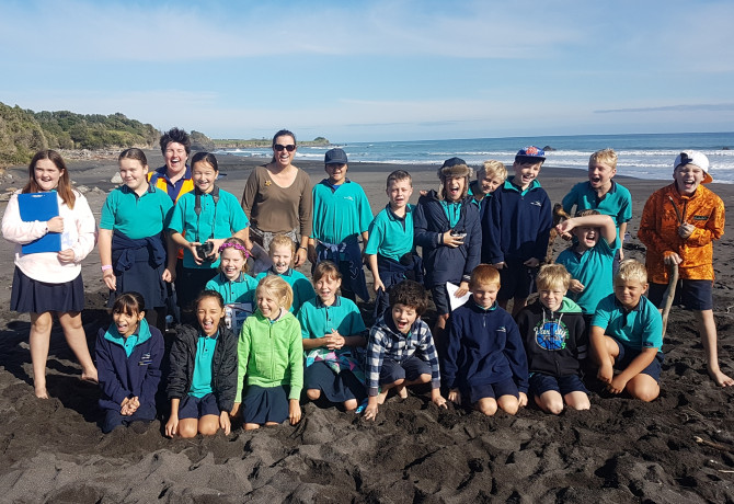 TRC Environment Education - Dr Emily Roberts with students at the beach